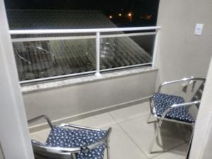 Un balcón o terraza de APTO PRAIA DOS INGLESES