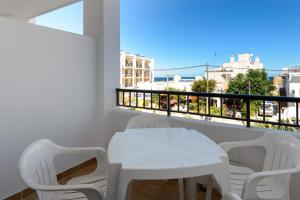 A balcony or terrace at Apartamentos San Antonio Beach