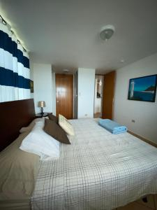 A bed or beds in a room at Rincon by the Sea Penthouse
