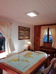 Una cama o camas en una habitación de La Casa del Viejo Manzano