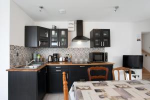 Cuisine ou kitchenette dans l'établissement Gîte du Charme Provençal
