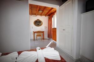 Ένα ή περισσότερα κρεβάτια σε δωμάτιο στο Domna Lakka