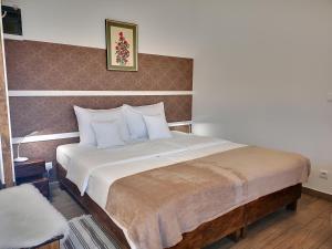 Postelja oz. postelje v sobi nastanitve PR`FIK Apartments