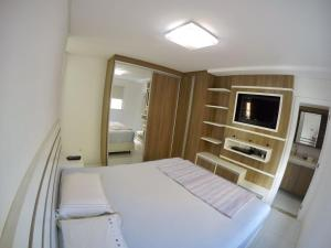 A bed or beds in a room at Apto alto padrão