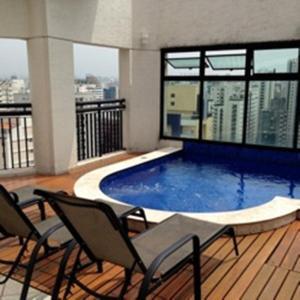 A piscina localizada em Flat em Moema ou nos arredores