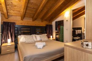 Ein Bett oder Betten in einem Zimmer der Unterkunft Il Giardino Di Lory