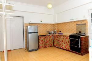 A kitchen or kitchenette at Luxor Guest House