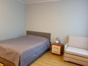 Voodi või voodid majutusasutuse Jõe Apartment toas