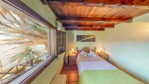 Ein Bett oder Betten in einem Zimmer der Unterkunft Villa Masca