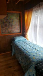 Cama o camas de una habitación en Cabañas Cercanas a Puerto Montt