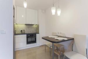 Kuchnia lub aneks kuchenny w obiekcie Modern Apartment Oldtown with River View