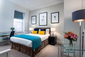 A bed or beds in a room at The Apartments, Chelsea