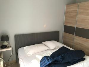 Ein Bett oder Betten in einem Zimmer der Unterkunft Appartement Koksijde