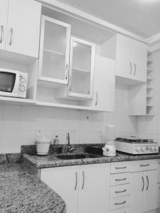 A kitchen or kitchenette at Flats Residence Bueno