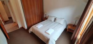 Una cama o camas en una habitación de Departamento Rocacindo