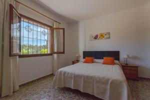 A bed or beds in a room at Cana Lali