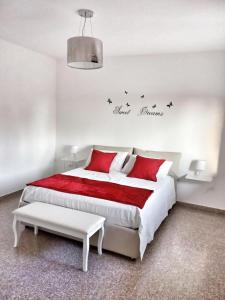 A bed or beds in a room at Red Tower Venice - 2 mins from VCE Airport- free Wifi
