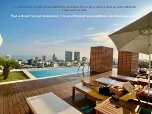The swimming pool at or near ALU Apartments - Miraflores Park