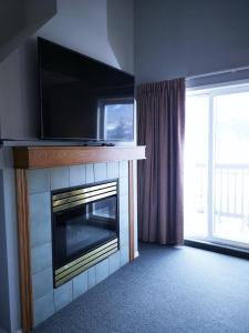 A television and/or entertainment center at Canadian Rockies Chalets