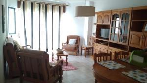 Uma área de estar em Apartamento Gago Coutinho