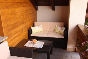 Ein Sitzbereich in der Unterkunft Appartement Penzkofer