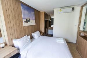 Кровать или кровати в номере The Chezz by Patsamon