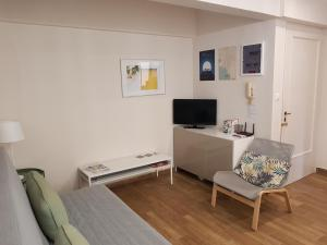 A television and/or entertainment centre at Cozy studio downtown Athens/Kolonaki