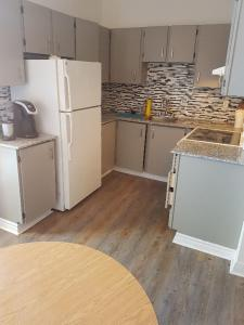 A kitchen or kitchenette at All New Great Location! 1-Bdrm Plateau Mont Royal