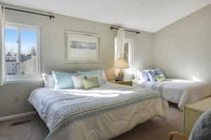 A bed or beds in a room at 211 Swedes Street by Long & Foster