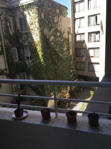 Un balcón o terraza de La Moneda House
