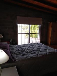 Una cama o camas en una habitación de CASA NOSTRA