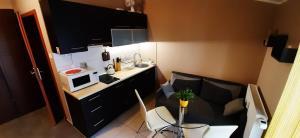 Telewizja i/lub zestaw kina domowego w obiekcie Apartament Słoneczna