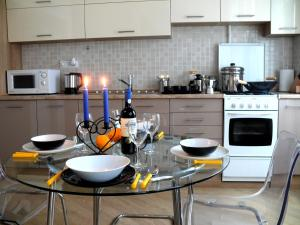 A kitchen or kitchenette at Flow Apartment