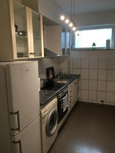 A kitchen or kitchenette at Messe & Ferien Apartments