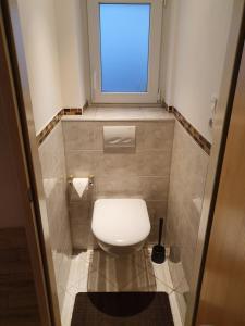 Ein Badezimmer in der Unterkunft T&K Appartements