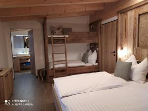 A bunk bed or bunk beds in a room at Alp-IN Lodges Kaprun