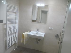 Ein Badezimmer in der Unterkunft Premium City Apartment Amadeus