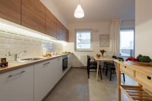 Virtuvė arba virtuvėlė apgyvendinimo įstaigoje P&O Serviced Apartments MORDOR