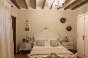 Cama o camas de una habitación en Casa Rosalía