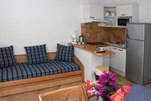 A kitchen or kitchenette at Adonis Borgo - Résidence Cala Bianca