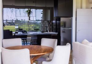 A kitchen or kitchenette at The Double View Mansions Bali
