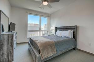 A bed or beds in a room at West Ballpark Downtown Denver 30 Day Stays