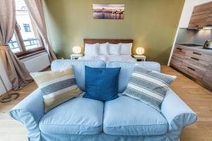 Ein Bett oder Betten in einem Zimmer der Unterkunft REZIDENCE U VLTAVY