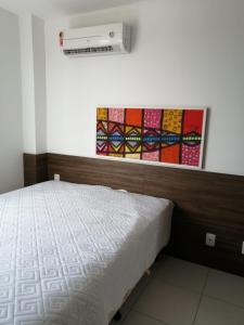 A bed or beds in a room at Apartamento Barra de São Miguel