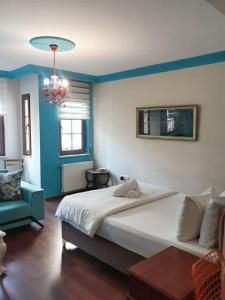 Кровать или кровати в номере Naz 40 Aparthotel