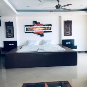 Кровать или кровати в номере View Talay 6 Pattaya Beach Apartment by Honey