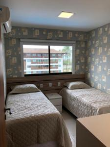 Cama ou camas em um quarto em FLAT CUPÊ BEACH LIVING - Beira Mar