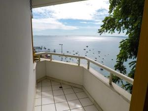 A balcony or terrace at Apartamento Gamboa de Cima