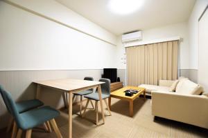 ランド-レジデンシャルホテル 福岡にあるシーティングエリア