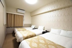 ランド-レジデンシャルホテル 福岡にあるベッド